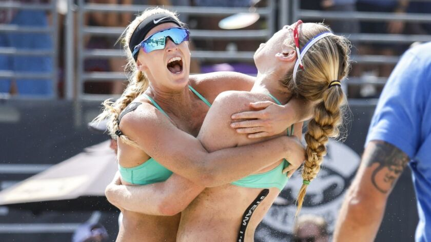 HERMOSA BEACH,CA --SUNDAY, JULY 29, 2018--Sara Hughes, left hugs partner Summer Ross after their def