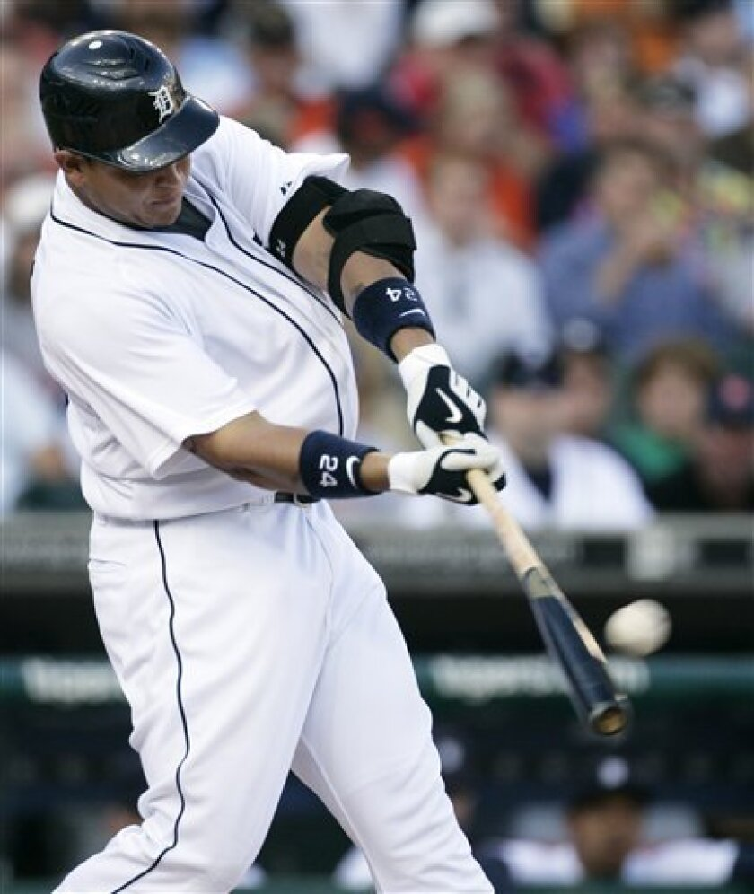 Detroit Tigers' Miguel Cabrera hits a solo home run off of Kansas City Royals starter Bruce Chen in the first inning of a baseball game Tuesday, July 7, 2009, in Detroit. (AP Photo/Duane Burleson)