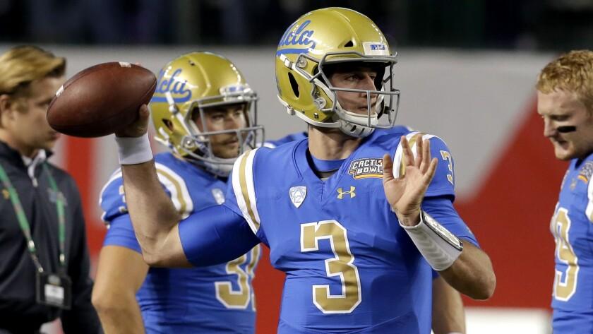 UCLA quarterback Josh Rosen warms up before an NCAA college football bowl game against Kansas State,