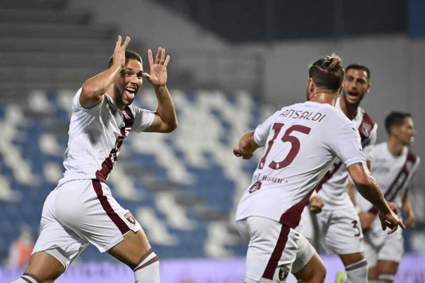 Torino's Marco Pjaca, left, celebrates scoring his side's first goal of the game during the Serie A soccer match between Sassuolo and Torino, at the Mapei stadium in Reggio Emilia, Italy, Friday, Sept. 17, 2021. (Massimo Paolone/LaPresse via AP)