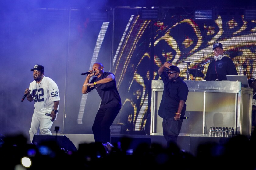 """Ice Cube is joined by Dr. Dre, MC Ren and DJ Yella, from left, at Coachella. They dedicated their performance to the late N.W.A founding member """"Eazy-E"""" and to Prince."""