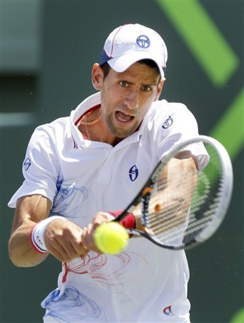 Novak Djokovic, of Serbia, returns a shot from Andy Murray, of Great Britain, during the men's singles final match at the Sony Ericsson Open tennis tournament on Sunday, April 1, 2012, in Key Biscayne, Fla. (AP Photo/Lynne Sladky)