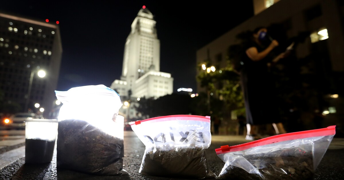 L.A. protesters dump bags of dirt at federal courthouse to oppose Exide plant abandonment