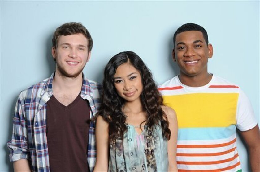 "In this May 10, 2012 photo released by Fox, the final three contestants from the singing competition series ""American Idol,"" from left, Phillip Phillips, Jessica Sanchez and Josh Ledet pose in Los Angeles. (AP Photo/Fox, Michael Becker)"