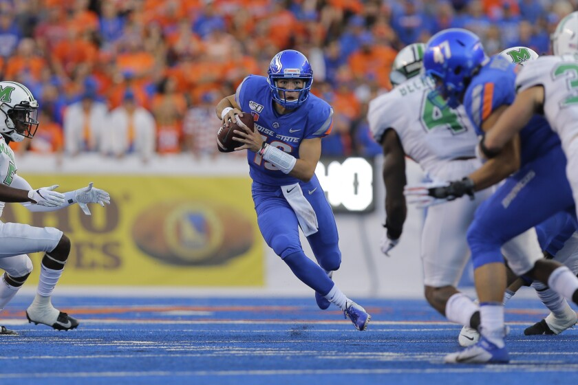 Boise State quarterback Hank Bachmeier (19) runs the ball during the first half against Marshall in Boise, Idaho on Friday.