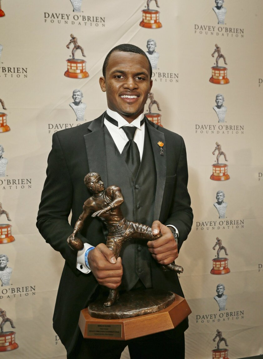 Deshaun Watson, from Clemson University, poses for a photo after he received the Davey O'Brien Award as the nation's top NCAA quarterback, in Fort Worth, Texas, Monday, Feb. 15, 2016. (Paul Moseley/Star-Telegram via AP) MANDATORY CREDIT