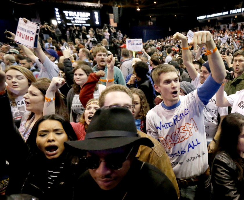 Protesters of Republican presidential candidate Donald Trump, right, chant after a rally on the campus of the University of Illinois-Chicago on March 11.