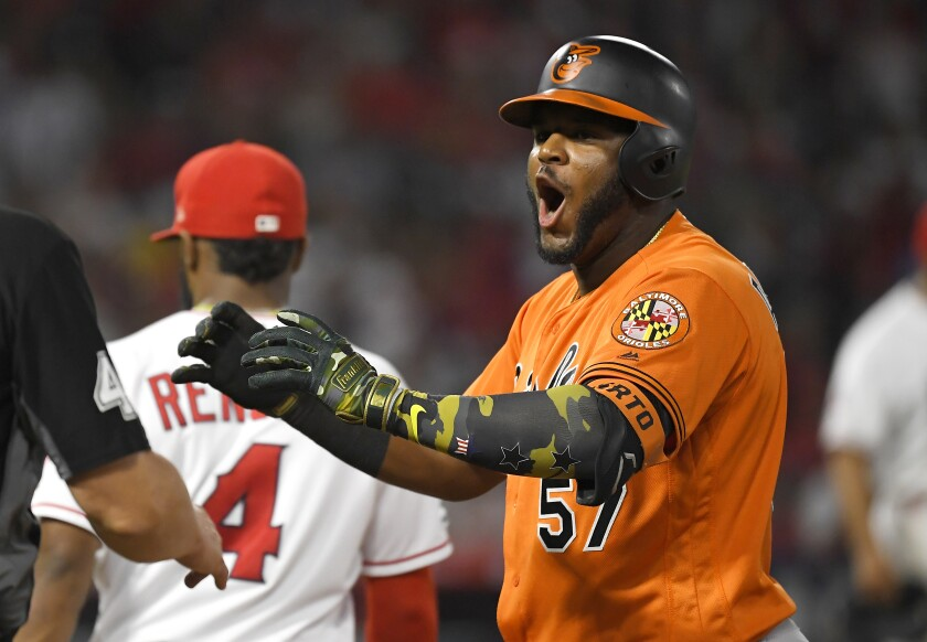 Baltimore Orioles' Hanser Alberto, right, celebrates after hitting a two RBI single as Los Angeles Angels second baseman Luis Rengifo walks away during the eighth inning of a baseball game Saturday, July 27, 2019, in Anaheim, Calif. (AP Photo/Mark J. Terrill)