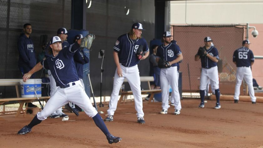 Padres pitchers, from left, Chris Paddack, Trey Wingenter, Bryan Mitchell, Craig Stammen and Jose Castillo, throw bullpen sessions Thursday.
