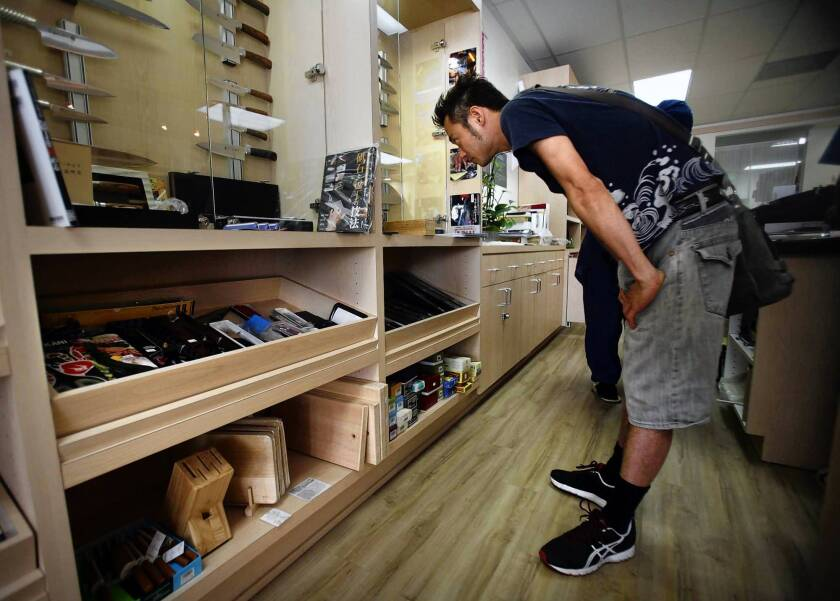 Sushi chef Kazu Ueda browses sushi knives at Hitachiya, in Rolling Hills Plaza in Torrance.