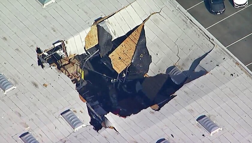 This photo taken from video provided by KABC-TV shows where an F-16 fighter jet crashed into a wareh