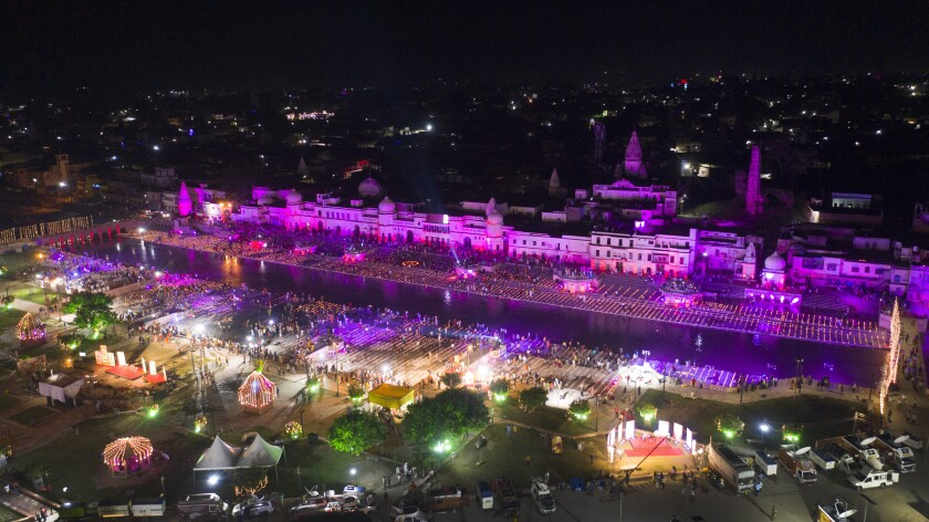 An illuminated city of Ayodhya is seen on the eve of a groundbreaking ceremony of a temple dedicated to the Hindu god Ram in Ayodhya, India, Tuesday, Aug. 4, 2020. Wednesday's groundbreaking ceremony follows a ruling by India's Supreme Court last November favoring the building of a Hindu temple on the disputed site in Uttar Pradesh state. Hindus believe their god Ram was born at the site and claim that the Muslim Emperor Babur built a mosque on top of a temple there. The 16th century Babri Masjid mosque was destroyed by Hindu hard-liners in December 1992, sparking massive Hindu-Muslim violence that left some 2,000 people dead. (AP Photo/Rajesh Kumar Singh)