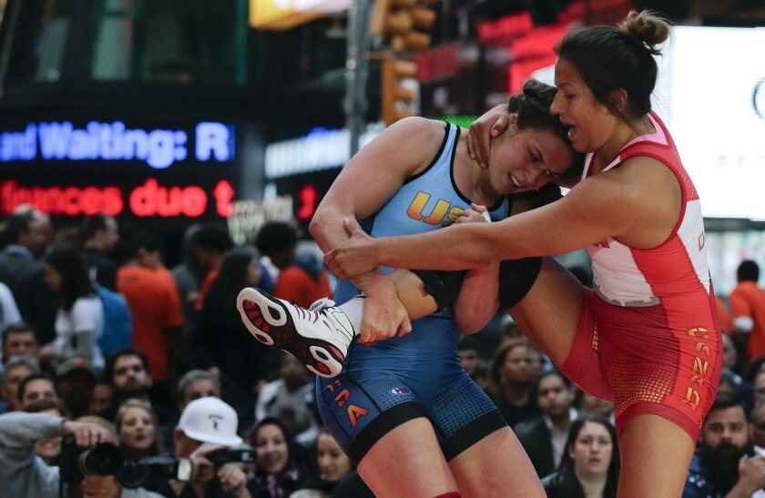 FILE - In this May 19, 2016, file photo, Adeline Gray, left, attempts to take down Canada's Justina Di Stasio during the Beat the Streets wrestling exhibition in Times Square in New York. Gray is ranked No. 1 at 75 kilograms (165 pounds) and will attempt to win the first gold for U.S. women's wrest