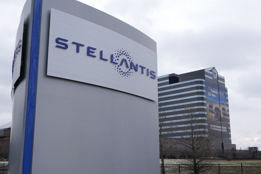 FILE - In this file photo taken on Jan. 19, 2021, the Stellantis sign is seen outside the Chrysler Technology Center, Tuesday,, in Auburn Hills, Mich. Carmaker Stellantis and Taiwan's Foxconn on Tuesday, May 18, 2021, announced plans to develop a jointly operated automotive supplier focusing on technology to make vehicles more connected, including artificial intelligence-based applications and 5-G communications. (AP Photo/Carlos Osorio)