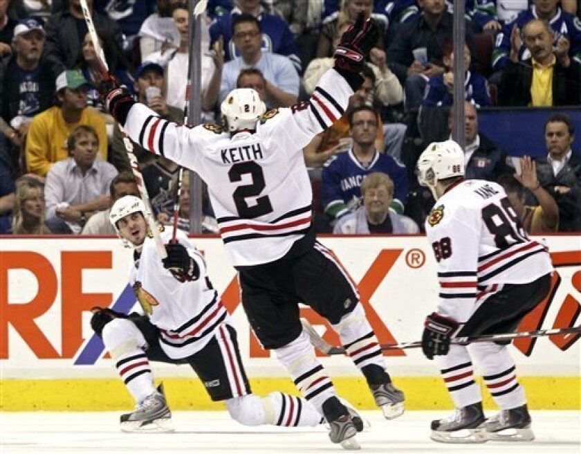 From left, Chicago Blackhawks' Dave Bolland celebrates his goal with Duncan Keith and Patrick Kane during the third period of Game 5 of an NHL hockey second-round playoff series at GM Place in Vancouver, Saturday, May 9, 2009. (AP Photo/The Canadian Press, Darryl Dyck)