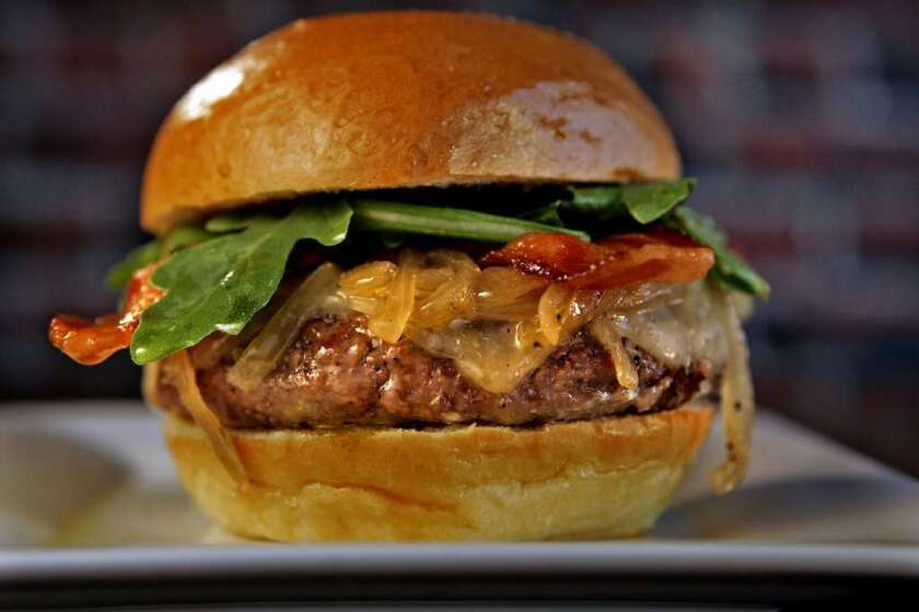 Golden State's burger has Harris Ranch beef, Fiscalini cheddar, arugula, applewood smoked bacon, aioli, ketchup and caramelized onions.