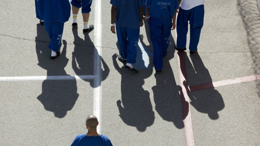 Inmates at North County Correctional Facility in Castaic, Calif. walk around the exercise yard on Oct. 11, 2017.