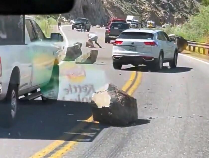 Boulders block U.S. 395 near the California-Nevada state line after an earthquake.