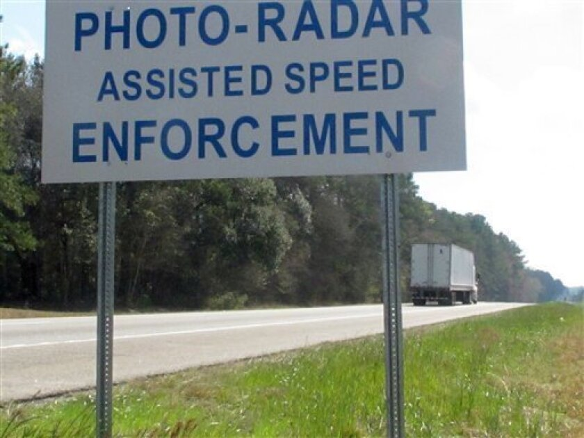 In this March 8, 2011 photo, a sign warns motorists on Interstate 95 in Ridgeland, S.C., about a speed camera system in use on the expressway in the town limits. The cameras in Ridgeland have spotted thousands of speeding motorists and won accolades from highway safety advocates. But they've also attracted opposition from state lawmakers and sparked a federal court challenge. (AP Photo/Bruce Smith)