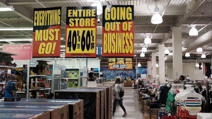 People shop on June 8 at a Toys R Us store in Brooklyn, N.Y., going through liquidation.