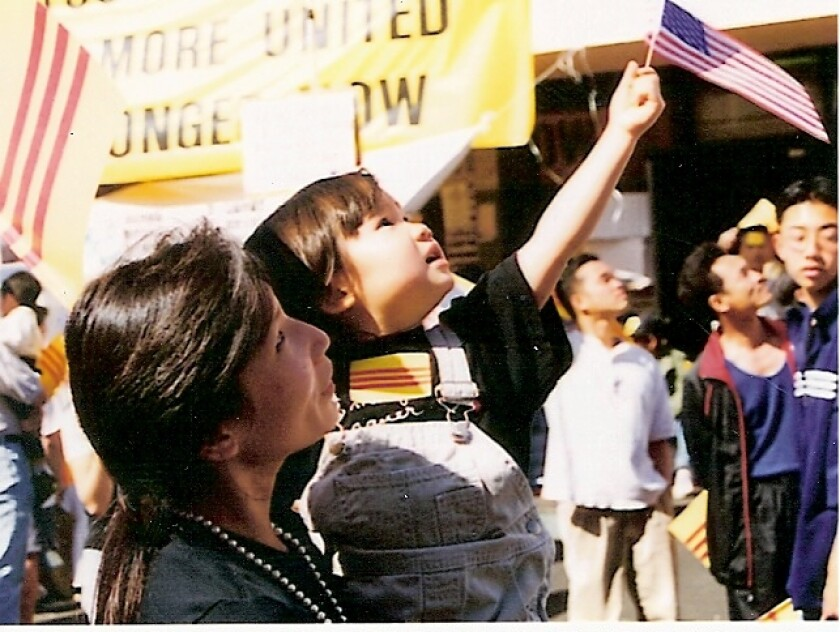In 1999. Annie Wright, left, took her daughter, Lacy Lew Nguyen Wright, to a protest in Little Saigon