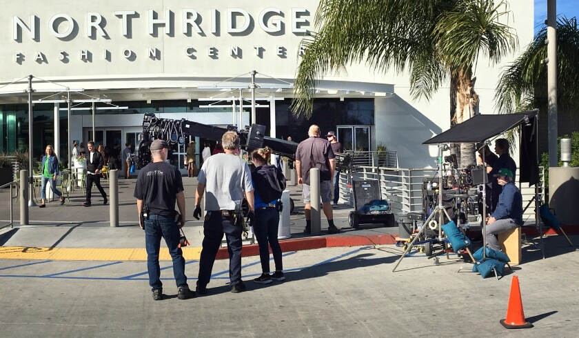 """Crews film a scene for the Netflix movie """"The Prom"""" at the Northridge Fashion Center in the San Fernando Valley. It filmed this year before the coronavirus pandemic shut down production."""