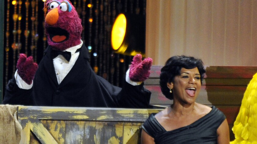 Actress Sonia Manzano, right, performs at the Daytime Emmy Awards in Los Angeles in 2009.