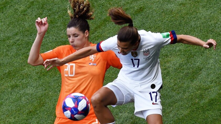 Netherlands defender Dominique Bloodworth, left, and U.S. forward Tobin Heath battle for the ball during the opening minutes of the Women's World Cup final in Lyon, France, on Sunday.