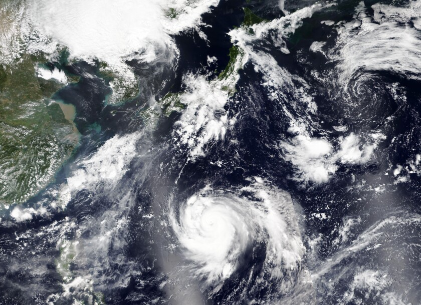 This Thursday, Sept. 3, 2020, satellite image released by NASA Worldview, Earth Observing System Data and Information System (EOSDIS) shows tropical storm Haishen, lower center, sweeping northward. Haishen could gain in ferocity before slamming into Japan's southern islands of Kyushu and Shikoku before reaching the Korean Peninsula on Monday. (NASA via AP)
