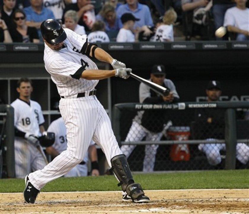 Chicago White Sox's Paul Konerko launches a home run off Seattle Mariners starting pitcher Michael Pineda during the fourth inning of a baseball game Monday, June 6, 2011 in Chicago. (AP Photo/Charles Rex Arbogast)