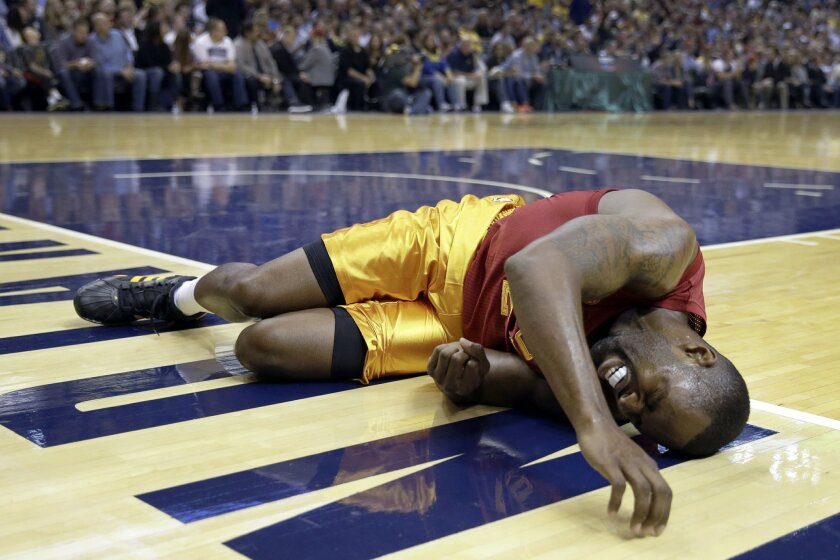 Indiana Pacers guard Rodney Stuckey lies on the court after being injured during the first half of an NBA basketball game against the Miami Heat in Indianapolis, Friday, Nov. 6, 2015. (AP Photo/AJ Mast)