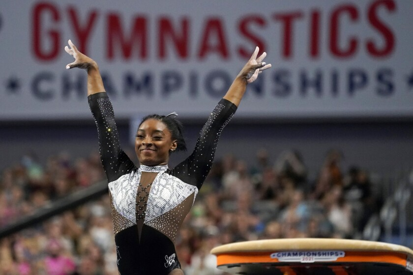 Simone Biles celebrates after competing in the vault.