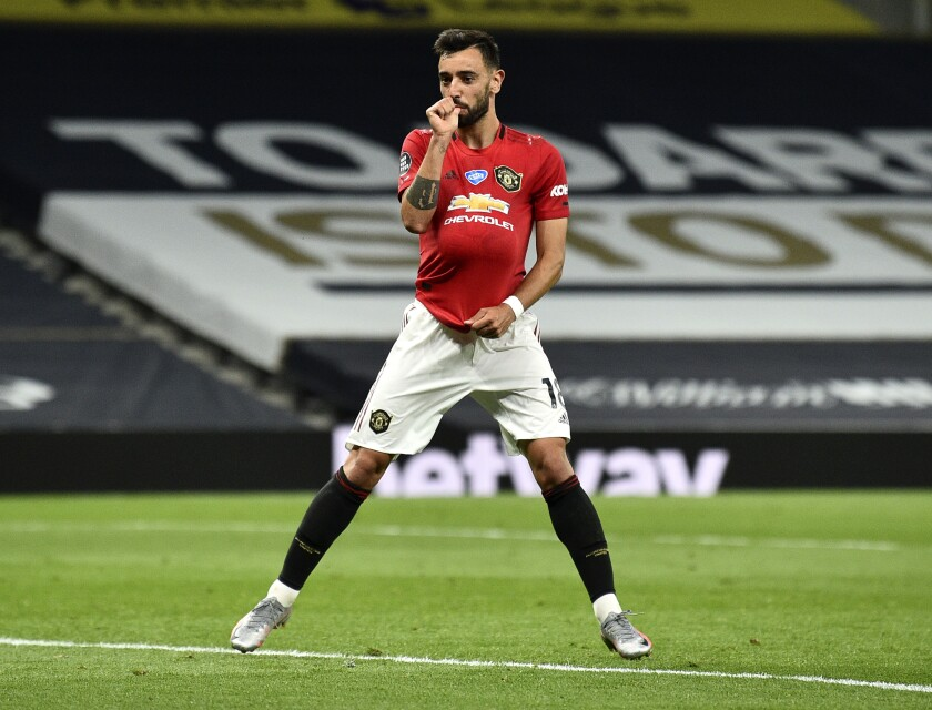 Manchester United's Bruno Fernandes reacts after kicking a penalty to level the scores during the English Premier League soccer match between Tottenham Hotspur and Manchester United at Tottenham Hotspur Stadium in London, England, Friday, June 19, 2020. (AP Photo/Glyn Kirk, Pool)