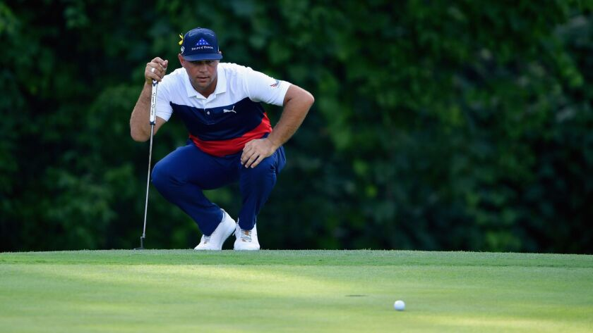 Gary Woodland lines up a putt on the 17th green during the first round of the 2018 PGA Championship at Bellerive Country Club on August 9, 2018 in St Louis, Missouri.