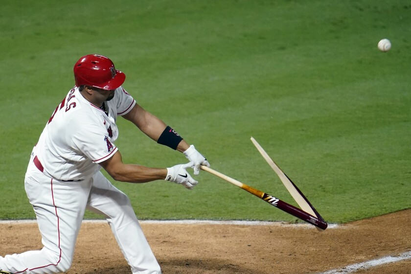 Albert Pujols breaks his bat as he pops out during the third inning of a game against the Diamondbacks.