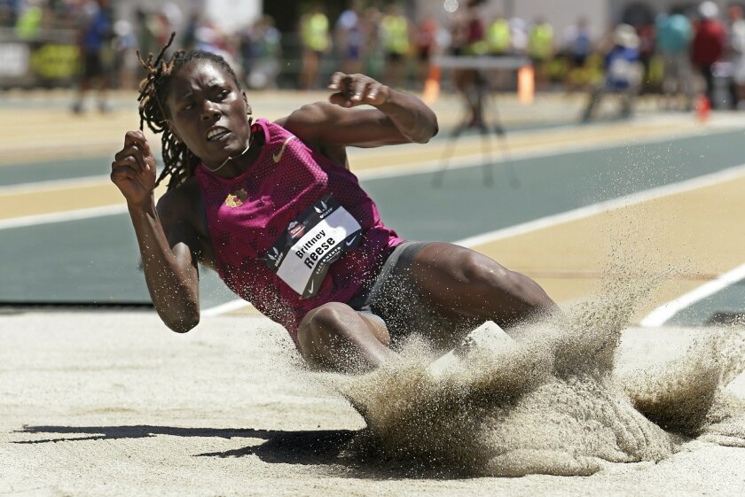 Brittney Reese lands in the pit during the women's long jump at the U.S. outdoor track and field championships, Saturday, June 28, 2014, in Sacramento, Calif. Reese won with a jump of 22 feet, 8 1/2 inches. (AP Photo/Rich Pedroncelli)