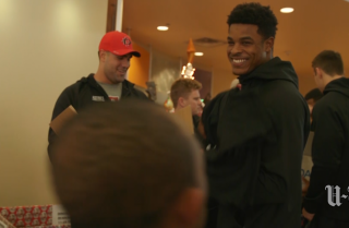 Aztec football players lend a hand at Opportunity Village