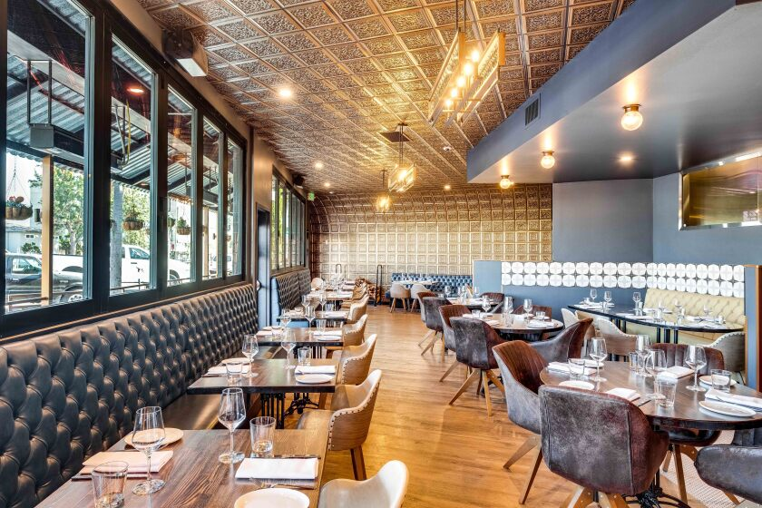 Rare Society's main dining room, with a new window into the kitchen (upper right), feels light years away from the cocktail bar Hundred Proof.