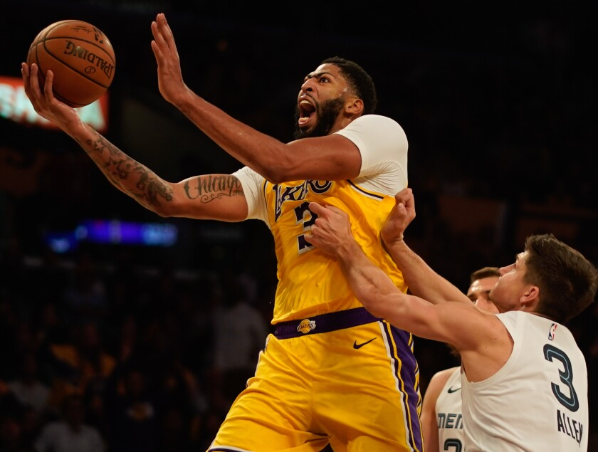 Lakers forward Anthony Davis goes for a layup against the Grizzlies on Oct. 29, 2019, at Staples Center.