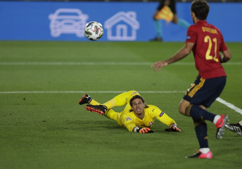 Switzerland's goalkeeper Yann Sommer watches as Spain's Oyarzabal goes to shoot at goal but fails to score after hitting the postduring the UEFA Nations League soccer match between Spain and Switzerland in Madrid, Spain, Saturday, Oct. 10, 2020. (AP Photo/Manu Fernandez)