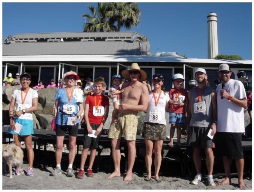 Winners of the 32nd annual Jake's Del Mar Beach Fun Run, which raised $8,000 for two area groups.