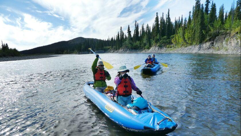 Inflatable canoes take travelers down the Kugururok River in Alaska's Noatak National Preserve.