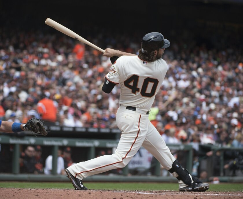 San Francisco Giants' Madison Bumgarner hits a solo home run in the bottom of the third inning off Dodgers starter Clayton Kershaw during a baseball game, Thursday, May 21, 2015 in San Francisco. (Jose Luis Villegas/The Sacramento Bee via AP) MAGS OUT; LOCAL TELEVISION OUT (KCRA3, KXTV10, KOVR13, KUVS19, KMAZ31, KTXL40); MANDATORY CREDIT