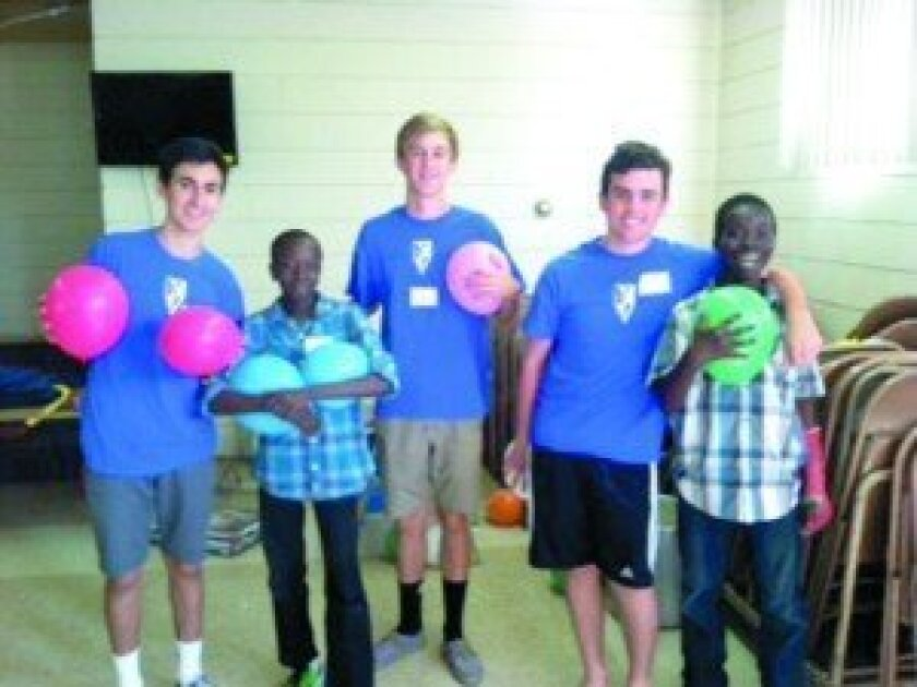 "Noah, Ryan, Miles and their new friends take a break from the ""Define Gravity"" Balloon Game. Courtesy photo"