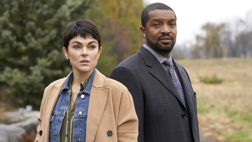 "Serinda Swan and Roger Cross in ""Coroner"" on The CW."