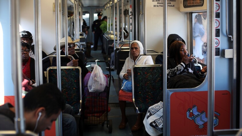 Passengers ride the Metro Blue Line towards Long Beach on January 23. Major portions of the Metro Blue Line will close for eight months starting this weekend, inconveniencing tens of thousands of daily riders.