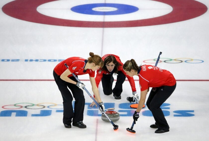 Eve Muirhead, center, of Great Britain in action during the match against Japan.