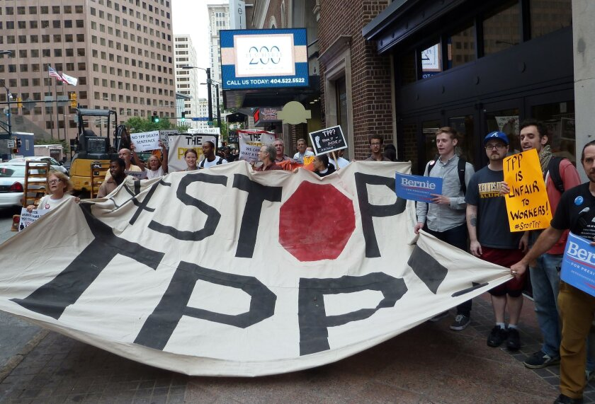 Protesters call for the rejection of the Trans-Pacific Partnership trade deal under negotiation in Atlanta on Thursday.