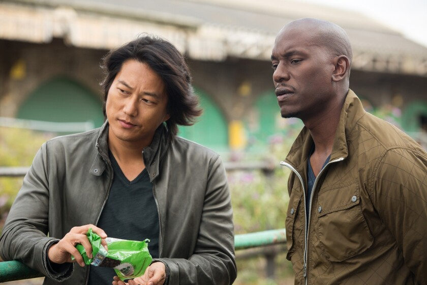 """Sung Kang as Han and Tyrese Gibson as Roman in """"Fast & Furious 6."""""""