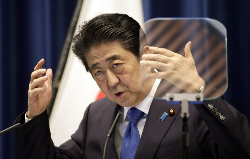 Japanese Prime Minister Shinzo Abe speaks during a press conference at the prime minister's official residence in Tokyo Wednesday, June 1, 2016. Abe said Wednesday he is postponing a sales tax hike planned for next year to help nurse along Japan's faltering economic recovery.(AP Photo/Eugene Hoshik
